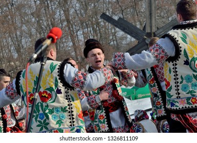 Chernivtsi,Bukovyna,Ukraine - January 13, 2019: Folklore men collective perfoms national dancing and singing during the ethnic festival of Christmas Carols in open-air museum of folk architecture
