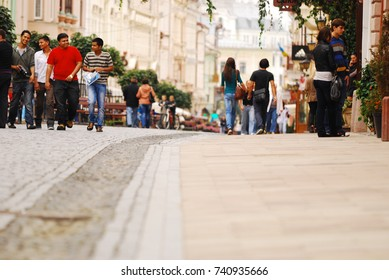 CHERNIVTSI,UKRAINE 10 SEPTEMBER, 2011. Foreign students and tourists are walking in the city center on weekends