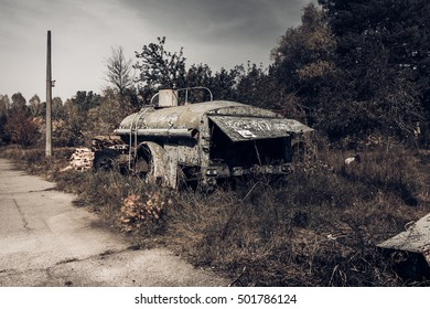 Chernobyl exclusion zone.  Autumn in zone of exclusion. Zone of high radioactivity. Abandoned car near the ruins of Pripyat city. Chernobyl disaster. Ghost town of Pripyat. Ukraine.