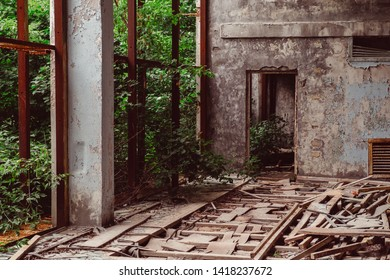 Chernobyl Exclusion Zone / Ukraine - July 2016: School gym in destroyed abandoned ghost city Pripyat ruins after disaster. Fallout lost town, apocalyptic building.