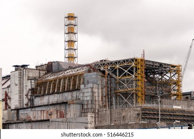 Chernobyl nuclear power plant. View on old destroyed sarcophagus before cover station of new safety confinement. Pripyat abondoned zone, Ukraine
