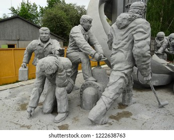Chernobyl / Ukraine - 05 02 2018: The Monument to the Chernobyl Liquidators, on left a doctor hurrying to victim of radioation overdose, on right workers of nuclear plant reducing impact of disaster