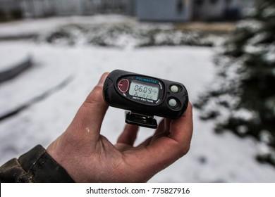Chernobyl, Ukraine - December 2017: Geiger meter showing radioactivity level exceeding norm in Chernobyl exclusion zone, Chernobyl, Ukraine
