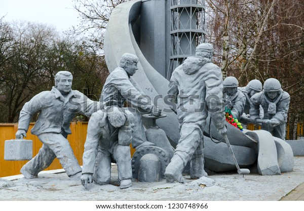 """CHERNOBYL, UKRAINE - NOVEMBER 11, 2018: Monument to firefighters who participated in liquidation of consequences of accident at Chernobyl nuclear power plant (""""Those who saved world"""")"""