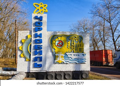CHERNOBYL, UKRAINE - NOVEMBER 12, 2016: Chernobyl exclusion zone. Ruins of abandoned Pripyat city. Autumn in zone of exclusion. Chernobyl sign. Text in russian: Chernobyl (name of the city).