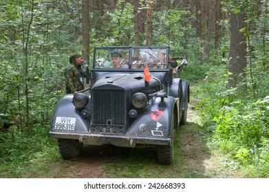 """CHERNOGOLOVKA, MOSCOW REGION, RUSSIA - JUNE 21, 2013: German retro car Horch-901, in the forest, 3rd international meeting """"Motors of war"""" near the city Chernogolovka, Moscow region,  front view"""