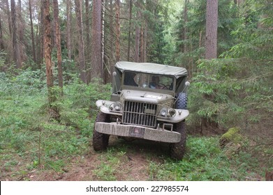 """CHERNOGOLOVKA, MOSCOW REGION, RUSSIA-JUNE 21, 2013: U.S. army Dodge WC-51 in the woods on a heavy road, 3rd international meeting """"Motors of war"""" near the city Chernogolovka"""