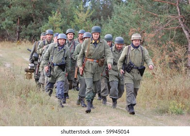 CHERNOGOW, UKRAINE - AUG 29: Members of Red Star military  history club wear historical German paratrooper  uniform during historical reenactment of  WWII, August 29, 2010 in Chernigow, Ukraine