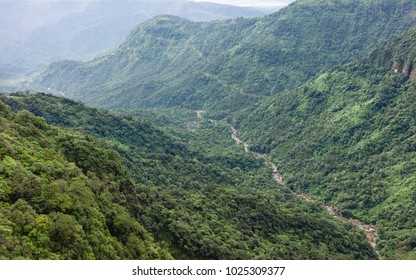 Cherrapunjee, Meghalaya, India. Deep valley in the Khasi hills and river with slopes of forest and peaks and the border with Bangladesh in the distance at dawn near Cherrapunjee, Meghalaya, India.
