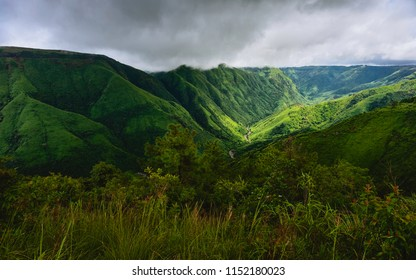 Cherrapunjee, Meghalaya, India. Monsoon clouds gather over the rolling landscape of the Khasi hiills with deep valley gorge and steep slopes near Cherrapunjee, Meghalaya, India.