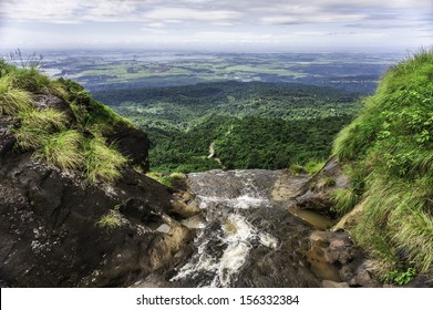 Cherrapunjee, Meghalaya, India: Waterfall from the Khasi Hills overlooking the road to and forests of Bangladesh near Cherrapunjee, the wettest place on earth, in Meghalaya, north east India.