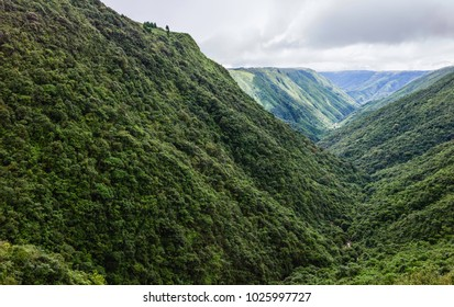 Cherrapunji, Meghalaya, India. Storm clouds drift in over the Khasi Hills as light breaks through the clouds to highlight the impressive contours of the mountains near Cherrapunjee, Meghalaya, India.