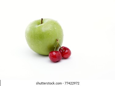 Cherries and an apple  isolated on white