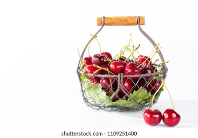 Cherries in a basket with white background