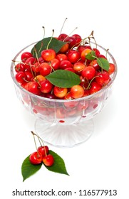 cherries in a beautiful glass dish isolated on white background