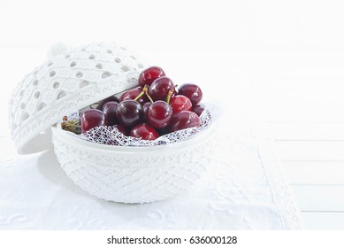 Cherries in bowl on white background
