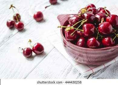 Cherries. Cherry. Cherries in color bowl and kitchen napkin. Red cherry. Fresh cherries. Cherry on white background. healthy food concept