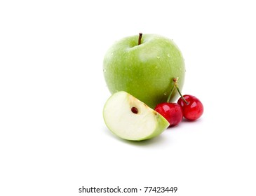 Cherries with a Granny Smith apple isolated on white
