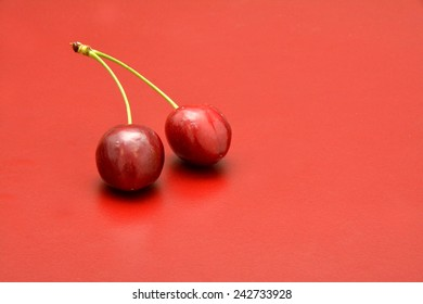 Cherries on red background