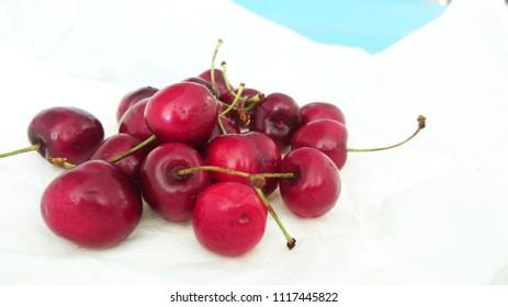 cherries on white napkins