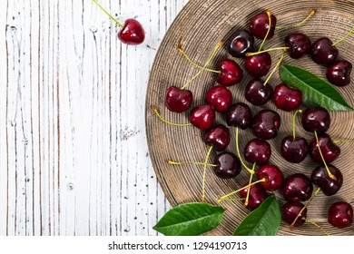 Cherries on White Wooden Background. Selective focus.