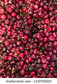 Cherries in a pile at fresh market