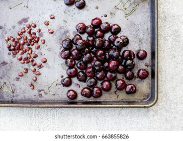 Cherries with Pits and Stems on a Rustic Metal Sheet Tray