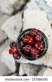 Cherries in red mug