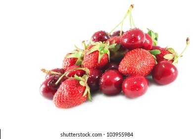 Cherries and strawberries with water droplets