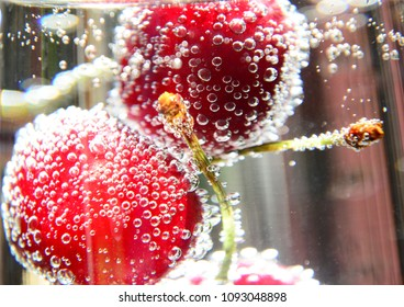 Cherries in water with bubbles,Cherry cocktail - in soda water