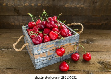 Cherries with water drops is in vintage wooden box