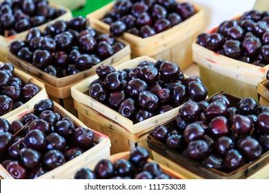 Cherries in wooden baskets at market