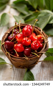 Cherry in basket on wood background