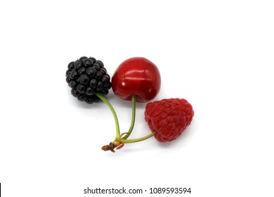 Cherry and blackberry united. Mutation of forest fruits. Different berries. Cherry, blackberry, raspberry artificially combined. Odd fruits.