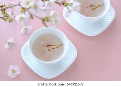 Cherry blossom tea with beautiful cherry blossom. Cup of Salted cherry blossom in hot water