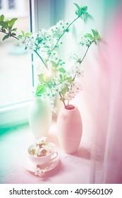 Cherry blossom in a white vase