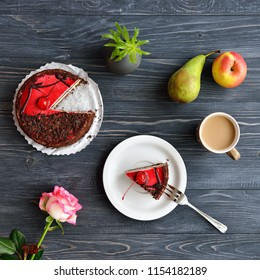 Cherry cake with chocolate. Apple, pear, cappuccino, flower top view. Flat lay