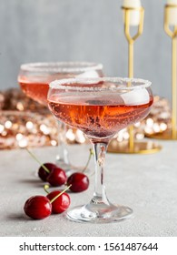 Cherry champagne in glasses with berries on Christmas or New Year's party