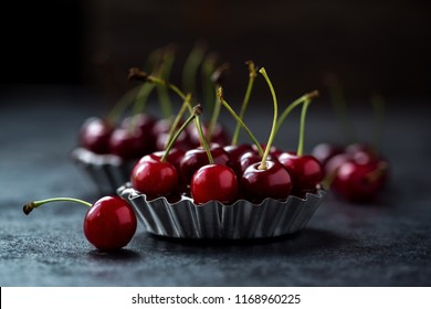 cherry in a chocolate tart on dark grunge background