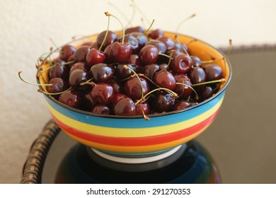 Cherry in colored bowl