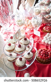 Cherry cupcakes on a cake stand, selective focus