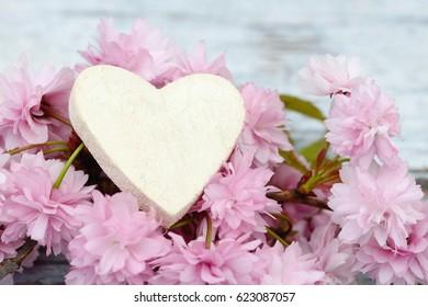 cherry flowers white heart on wood