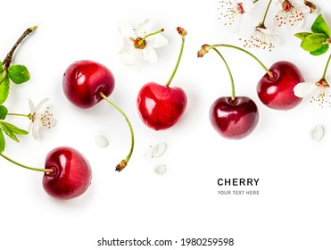 Cherry fruits and spring white cherry flowers creative layout. Springtime composition on white background. Healthy eating and food concept. Flat lay, top view, floral design. Copy space