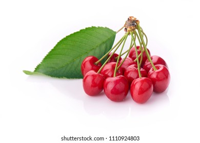 Cherry - Heap of berries isolated on white background.  A bunch of cherries with leaves attached