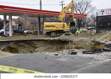 Cherry Hill, New Jersey - December 13, 2018: A large hole is seen in the ground where an old gas storage tank has been removed at a gas station that is being renovated on this date