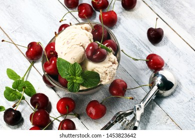 Cherry ice cream scoop with fresh cherries on a rustic background