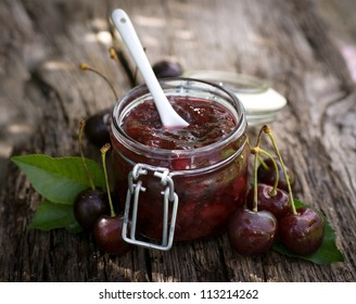 Cherry jam in a preserving glass