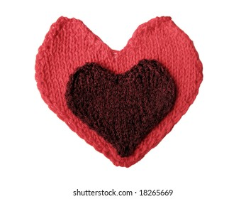 cherry knitted heart laying on the red one