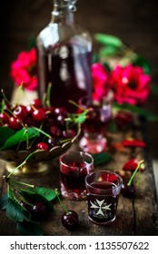 cherry liqueur kirsch  in the glasses .style vintage. selective focus