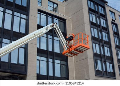 Cherry Picker at New Building Construction Site